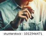 the man holding brushed chrome...   Shutterstock . vector #1012546471