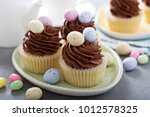 easter vanilla cupcakes with... | Shutterstock . vector #1012578325