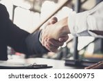 meeting and greeting concept ... | Shutterstock . vector #1012600975