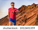 athlete runner checking cardio...   Shutterstock . vector #1012601359