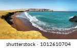 the coast and red sand beach of ... | Shutterstock . vector #1012610704