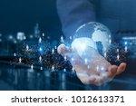 global business network in hand ... | Shutterstock . vector #1012613371