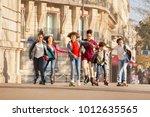 teenagers rollerblading along...   Shutterstock . vector #1012635565