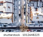 Small photo of Aerial view of snow covered traditional housing suburbs in England. Snow, ice and adverse weather conditions bring things to a stand still in the housing estates of a British suburb