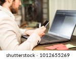 busy businessman working on...   Shutterstock . vector #1012655269