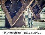 attractive man in urban setting ...   Shutterstock . vector #1012660429