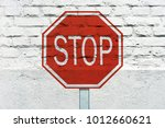 stop traffic sign stamped on... | Shutterstock . vector #1012660621