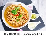 kao soi or thai curry noodles... | Shutterstock . vector #1012671541