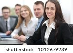 business woman and business team | Shutterstock . vector #1012679239