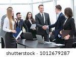 handshake business partners at... | Shutterstock . vector #1012679287