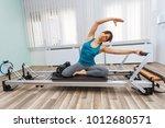 woman exercising on pilates... | Shutterstock . vector #1012680571