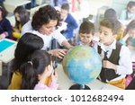female teacher and students... | Shutterstock . vector #1012682494