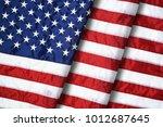 closeup ruffled american flag | Shutterstock . vector #1012687645