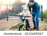 father is learning daughter to... | Shutterstock . vector #1012690567