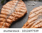 salmon juicy fillet grilled on... | Shutterstock . vector #1012697539