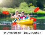 Child With Paddle On Kayak....