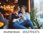 Enamored Couple Sitting In A...