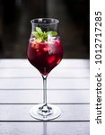 fruit infused purple cocktail... | Shutterstock . vector #1012717285