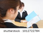 businesswomen meeting image | Shutterstock . vector #1012722784