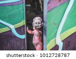dirty plastic naked baby doll... | Shutterstock . vector #1012728787