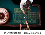 man croupier and woman playing... | Shutterstock . vector #1012731481