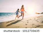 happy loving family mother and... | Shutterstock . vector #1012733635