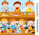 many kids eating in the canteen ... | Shutterstock .eps vector #1012735111