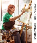 artist painting easel in studio....   Shutterstock . vector #1012739869