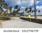 Small photo of Parks fun of walking and biking trails as well as volleyball nets abound in Miami Beach, Florida along Ocean Drive.