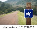 small blue sign and path ... | Shutterstock . vector #1012748797