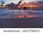 isla mujeres sunset on the... | Shutterstock . vector #1012750315