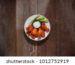 spicy buffalo wings on plate... | Shutterstock . vector #1012752919