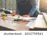 carpenter working on... | Shutterstock . vector #1012759561