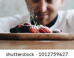close up young chef decoration... | Shutterstock . vector #1012759627