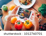 woman hand take photo food with ... | Shutterstock . vector #1012760701