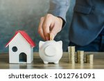 businessman with model house... | Shutterstock . vector #1012761091
