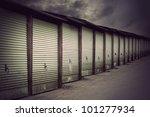 Row Of Metal Garage Doors In...