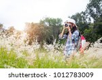 little girl take pictures in... | Shutterstock . vector #1012783009