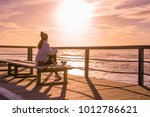 girl with skateboard watching... | Shutterstock . vector #1012786621