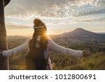 cheering young woman traveler... | Shutterstock . vector #1012800691