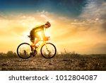 bike at the summer sunset on... | Shutterstock . vector #1012804087