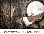 natural yogurt in a bowl. on a... | Shutterstock . vector #1012804441