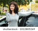 happy female driver showing car ...   Shutterstock . vector #1012805269