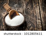 sugar with a scoop in a bowl.... | Shutterstock . vector #1012805611