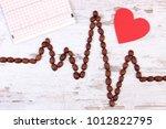 cardiogram line made of coffee... | Shutterstock . vector #1012822795