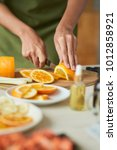 hands of woman slicing ripe... | Shutterstock . vector #1012858921