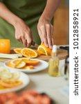 hands of woman slicing ripe... | Shutterstock . vector #1012858921