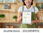 happy female small business... | Shutterstock . vector #1012858951