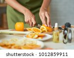 close up image of woman cutting ... | Shutterstock . vector #1012859911