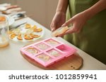 woman taking soap bars out of... | Shutterstock . vector #1012859941